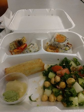 Yami Yami: Fresh Sushi, vegetable roll and kale, garbanzo, cucumber and tomato salad, very delicious.