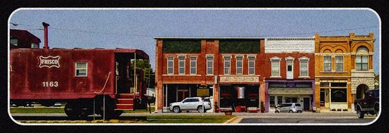 Historic building and caboose, survivors in downtown Pierce City, Missouri of the 2003 tornado.
