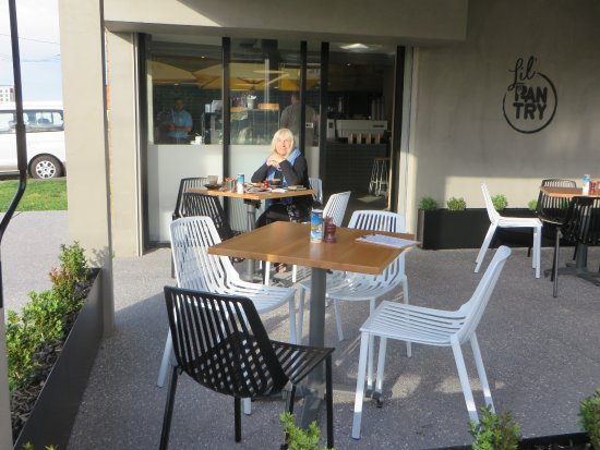 Tullamarine, Australia: Breakast at a table in the sun; quiet commercial area early morning.