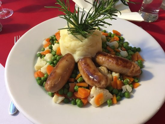 Tiverton, UK: Bangers & Mash, with mixed vegetables and gravy.