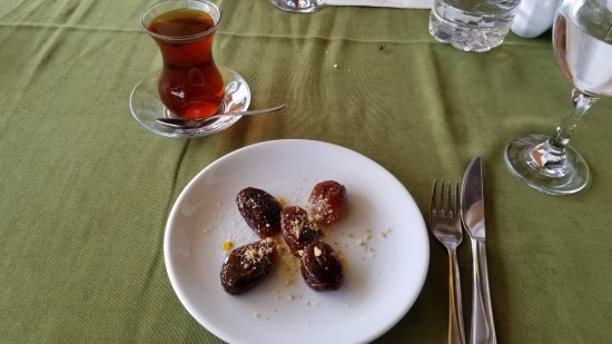 Ortahisar, Turchia: Local apricots in syrup, stuffed w/ crushed walnuts, and Turkish tea to close out a stellar meal