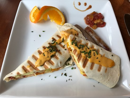 Brewster, MA: Veggie and egg burrito with Vermont maple sausage, mango salsa and a smile!