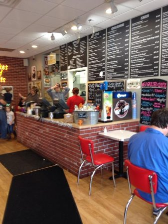East Aurora, NY: counter and wall menu