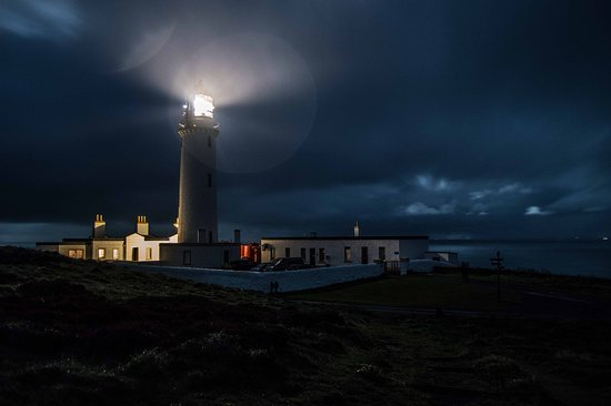 Drummore, UK: Light keepers cottage by night