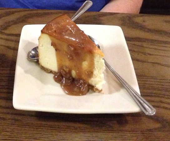 Muskogee, OK : New York cheesecake with praline sauce.
