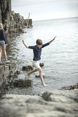 Cape Neddick, ME: cliff house_exterior_cliffs boy