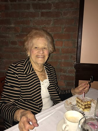 La Campagna: Here is my Mom at her birthday dinner having her special dessert-tiramisu with a candle on top!