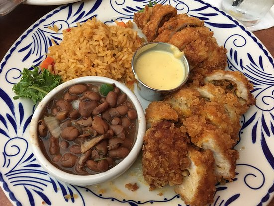 Abuelo's: Stuffed Chicken Medallions (stuffed with chorizo, poblano peppers, cheese, fried) w/beans and ri