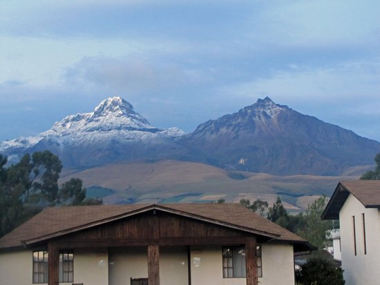 Machachi, Ecuador: the Ilinizas at first light from the lodge
