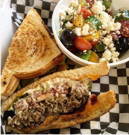 Wallaceburg, Canadá: Stubby goat burger and side Greek salad. Top pick every time.
