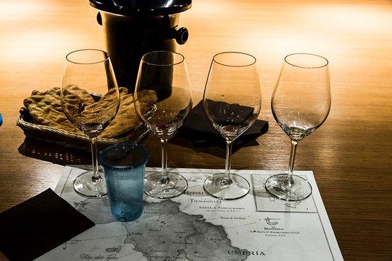 San Casciano in Val di Pesa, Italy: Antinori nel Chianti Classico - tasting glasses and map of the wineries.