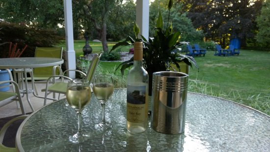 Hillsdale House Inn: A bottle and wine on the patio and gardens