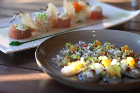 Cambridge, Australia: Blue-eye trevalla ceviche with wakame, mandarin, roe, baby herbs and miso crumble