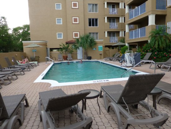 Inn of Naples: Pool area is small but attractive. Pool towels are provided. Shaded tables and chairs are provid