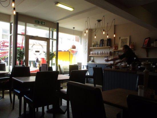 Ledbury, UK: A few tables on pavement, modern decor