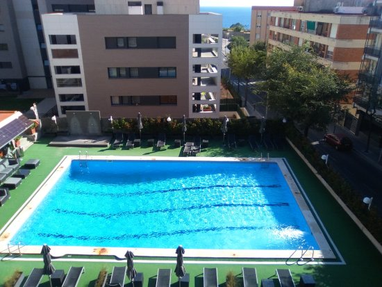 Astari Hotel: La piscina, vista desde la habitación.