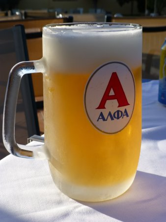 Chrissi Akti, Греция: A welcome draft beer at the end of a long day.