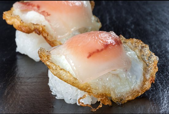 Emirate of Abu Dhabi, United Arab Emirates: Quail Egg Nigiri with Smoked Iberian Beef Bacon