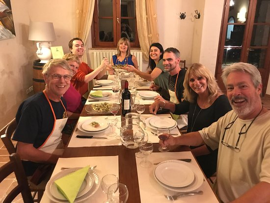 Peccioli, Italia: Hand made tagliatelle, chicken cacciatore, our family group sitting down to eat, learning how to