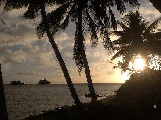 Coconut Grove Beachfront Cottages: Sunrise from the banana Bure......