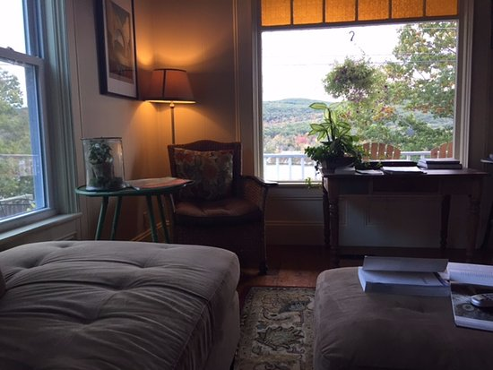 Bellows Falls, VT: Comfy couch in the living room/common area with a view to the Connecticut River and the mountain