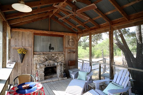 Spicewood, TX: screened porch with fireplace and marshmallows