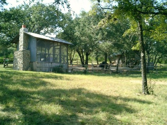 Spicewood, TX: screened porch and cabin tucked in the trees to the right