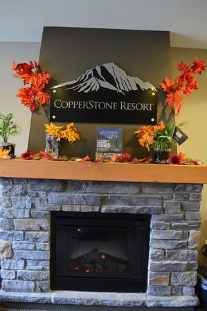 Copperstone Resort by CLIQUE: Fireplace in the lobby.