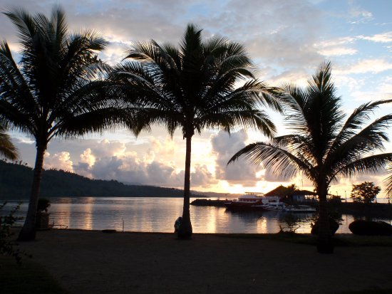 Tasik Ria Resort Manado: Sunset from our front porch of the Villa with the Jetty Bar