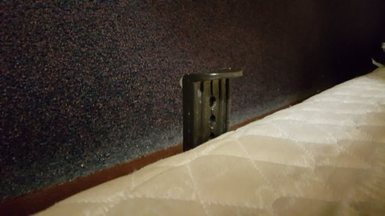 Super 8 York NE: Bedframe protruding from boxspring