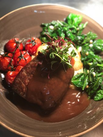 Haverhill, UK: Fillet with garlic & pine nut spinach, dauphinoise, grilled vine tomatoes and red wine jus.