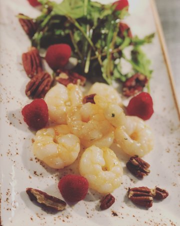 Haverhill, UK: King prawns served with rocket, raspberry balsamic, fresh raspberries and toasted pecans.