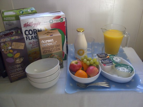Moreton, UK: help yourself side table followed by cooked breakfast if required