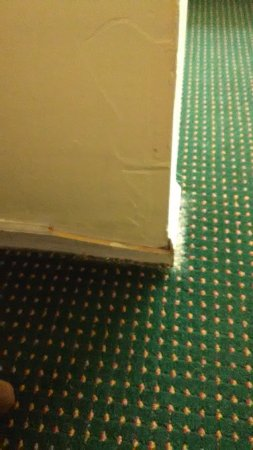 Berea, KY: busted floor moulding and unfinished wall