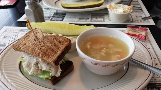 Maybrook, NY: A cup of chicken soup & chicken salad sandwich, with a pickle and coleslaw makes a mighty fine l