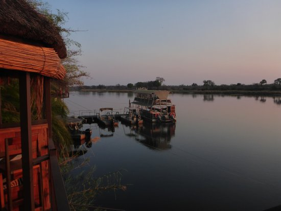 Caprivi Region, Namibia: Sunset over the river.