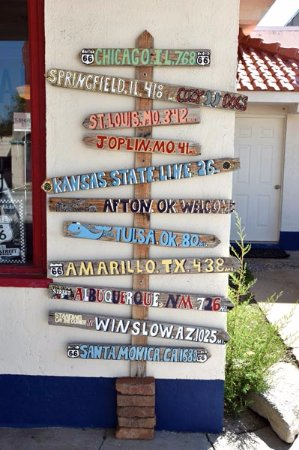 Afton, OK: Sign out front points the way to various towns on Route 66.