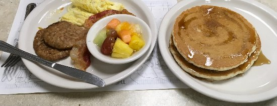 Spring Hill, FL: Sausage, bacon, scrambled eggs and pancakes (my wife was in HEAVEN)