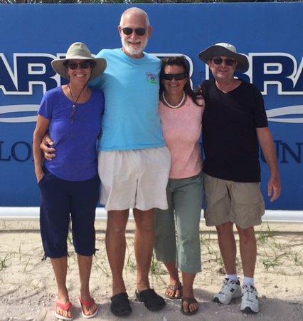 ฟอร์ตเพียร์ซ, ฟลอริด้า: The 4 of us standing in front of the sign at the entrance to their lagoon.
