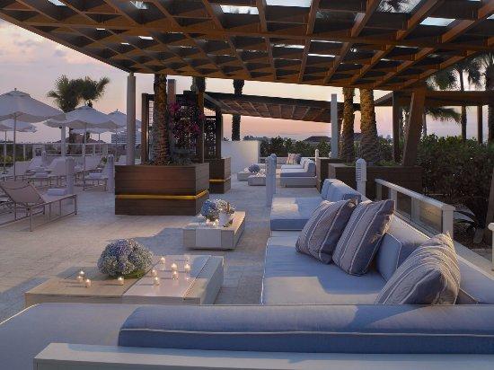 Surfside, FL: Rooftop Pool Seating at Dusk