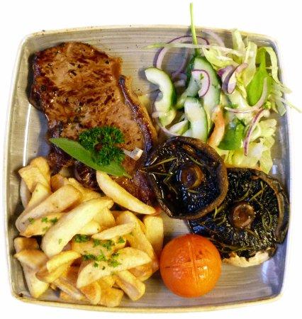 Pevensey, UK: 28 Day Matured Sirloin Steak, Portobello Mushrooms and Tomato with Chunk Chips