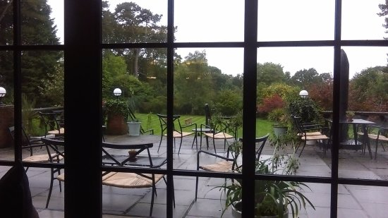Sway, UK: Looking out from the lounge over the patio and garden area