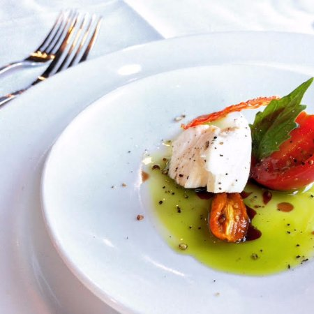 Ocean7 Restaurant, AQUA Bistro & Wine Bar : Olive oil and buffalo cheese... plate-lickable.