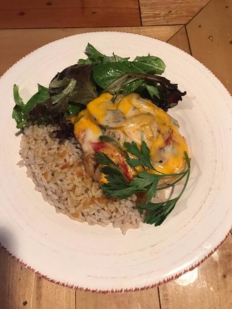 McClellanville, SC: Smothered chicken in rice and spinach