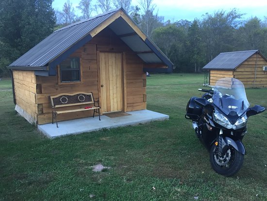 Tellico Plains, TN: Cabin 1, motorcycle and vehicle parking right up to your cabin no problem.