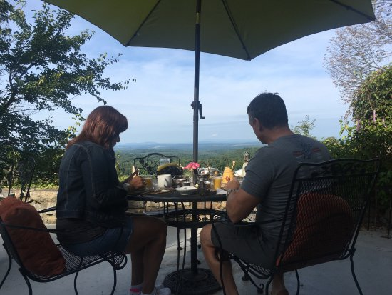 Millbrook, NY: Guests on the patio enjoying breakfast and western looking view of The Hudson River Valley.