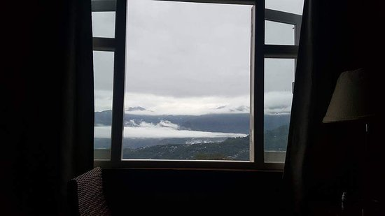 """Early morning clouds from our hotel room- View from """" deluxe suite """"  and late night citylights"""
