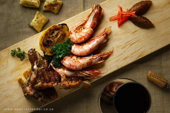 Margate, South Africa: Surf and Turf with tender lamb chops and tiger prawns accompanied by homemade gnocchis
