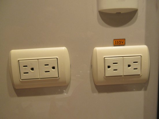Wall outlets are dual voltage and fit US plugs - Picture of Radisson ...