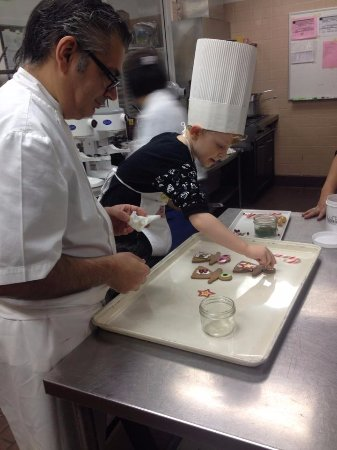 Four Seasons Hotel Vancouver: Chef Bruno making cookies at Christmas with children
